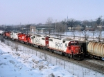 SOO 4401 leads a quartet of SOO GP38-2s and a CP SD unit east back to St. Paul Yard